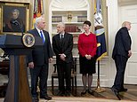 President Donald Trump, leaves after speaking but before signing executive orders regarding trade in the Oval Office at the White House, Friday, March 31, 2017, in Washington. Also pictured from left, Vice President Mike Pence, and National Trade Council adviser Peter Navarro. (AP Photo/Andrew Harnik)