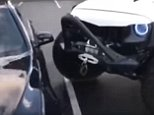 Video captures the moment a Jeep repeatedly rams into the side of a poorly parked BMW