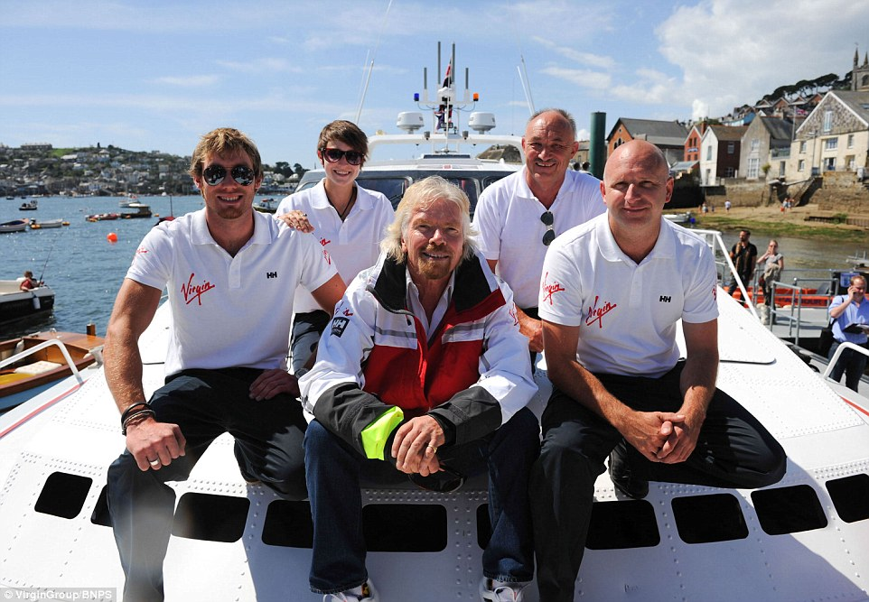 Branson was reunited with the boat in 2014. The £1.5m boat was sold to a Middle Eastern sheik in the late 80s but then spent the next 25 years languishing in a boatyard on the Spanish holiday island of Mallorca until boat-mad Dan Stevens (front right) stumbled across it in 2012
