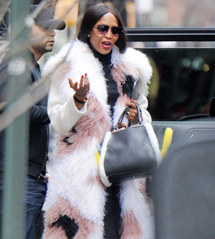 That'll get you noticed: Naomi Campbell caught the eye in a striking fur coat as she stepped out in New York City on Tuesday afternoon