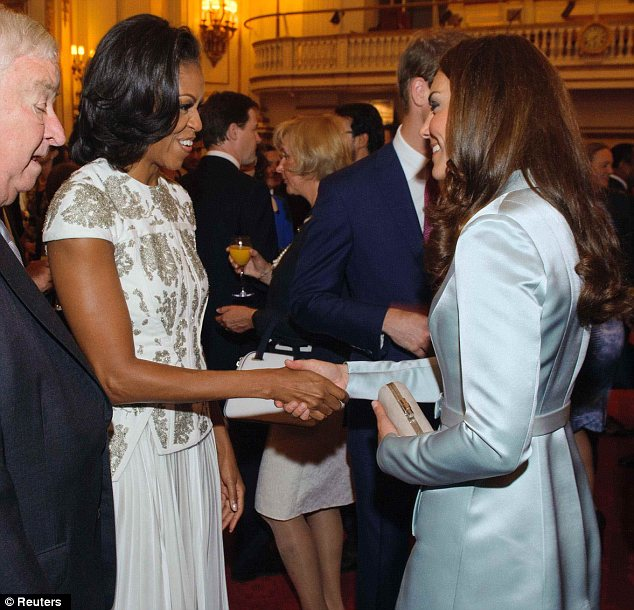 Michelle Obama (2nd L) and U.S. Ambassador Louis Susman (L) meet Catherine, the Duchess of Cambridge