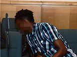 The Somali asylum seeker (left) handcuffed in court on rape and murder charges in Germany