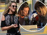 Peru drugs mule Michaella McCollum, left, flew into Ibiza today along with a friend, right, and headed straight to a bar in Mambos to watch the sunset go down over the island