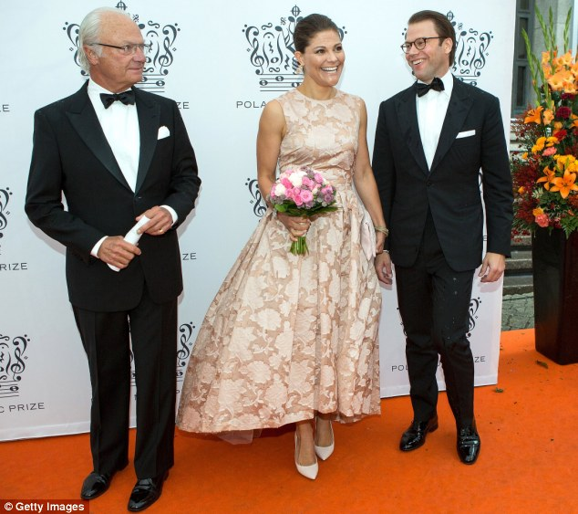 Royal decision: The Queen said her husband, King Carl XVI Gustaf and oldest daughter Crown Princess Victoria of Sweden, both pictured with her husband Prince Daniel at the ceremony on Tuesday, respected her decision