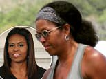 Michelle Obama is being hailed as inspirational after she was spotted wearing her normally straightened locks in a natural style. It isn't clear where or when the photo was taken, but it surfaced online on Sunday
