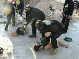 Volunteers from the Syrian Civil Defence, also known as the White Helmets, tried to extract survivors from the rubble following reported air-strikes on the rebel-held town of Saqba
