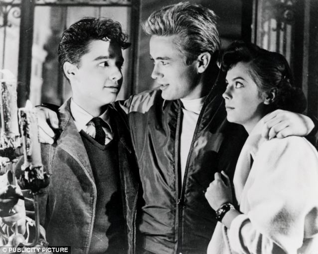 Silver screen: Dean shot to fame for his starring role in the film Rebel Without a Cause (1955) alongside Sal Mineo (left) and Natalie Wood