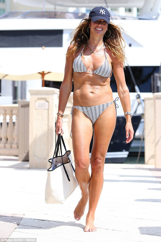 Fighting fit: The 48-year-old star flaunted her amazing figure in the monochrome swimsuit, showing off her flat stomach and muscular physique