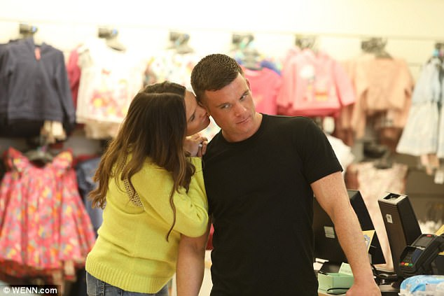 Smitten! Danielle and Michael didn't seem fazed by onlookers as they made a touchy-feely appearance during their shopping spree