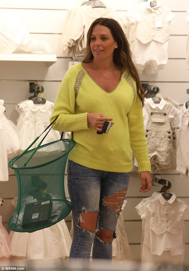 Stealing a look! Danielle hasn't yet confirmed the sex of her unborn baby but that didn't stop her looking through the clothing section