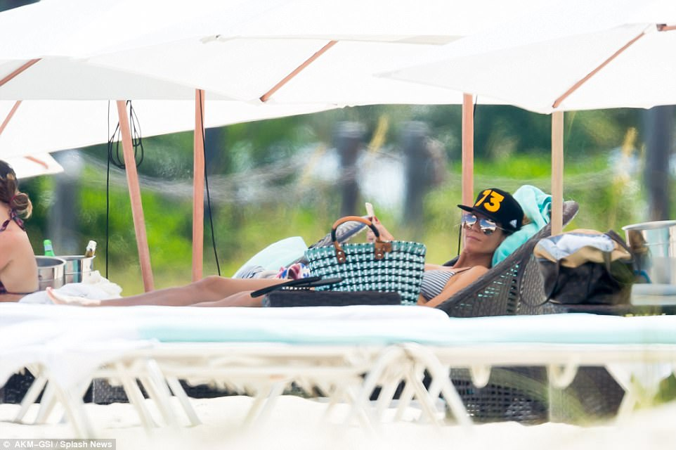 A little bit of time to relax: Later on, Heidi relaxed on a sun lounger under an umbrella as her children played on the beach
