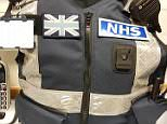 But all of the guards, who are employed by the NHS, have had an e-mail telling them to remove the black and blue patches from their vests, pictured
