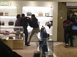Four men were seen fighting in Harrods on Saturday in the luxury handbag department at the Givenchy kiosk