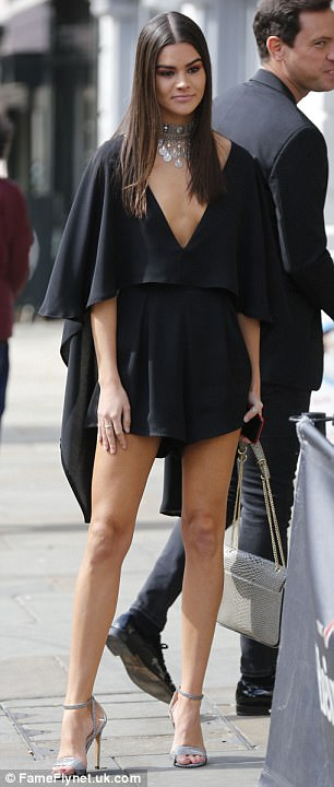 Quiet on set: Jade Lewis caught the eye in a backless black dress as she prepared to film scenes on a Colchester street