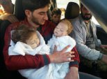 A devastated father has been pictured cradling the bodies of his dead twins after they were killed during the chemical attack in Khan Sheikhoun, in the rebel-held central province of Idlib, Syria