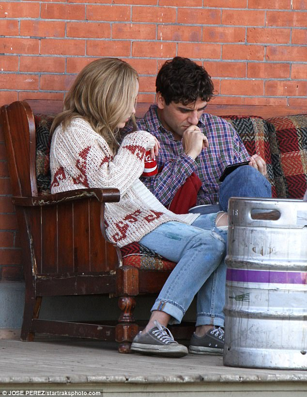 Deep in thought: She supped on a drink while they then both looked at his phone