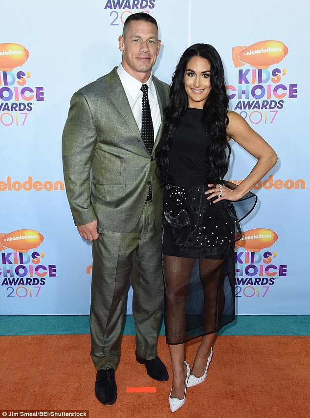 That's a yes!Bella, who has dated Cena sine 2012, answered him with a kiss (seen here in March at the Kids' Choice Awards)