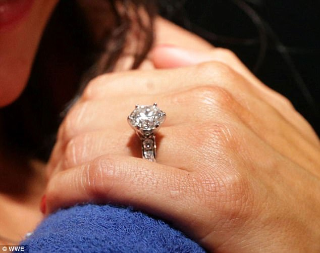 Serious bling: Nikki, 33, flashed the massive diamond after accepting John's proposal with a kiss