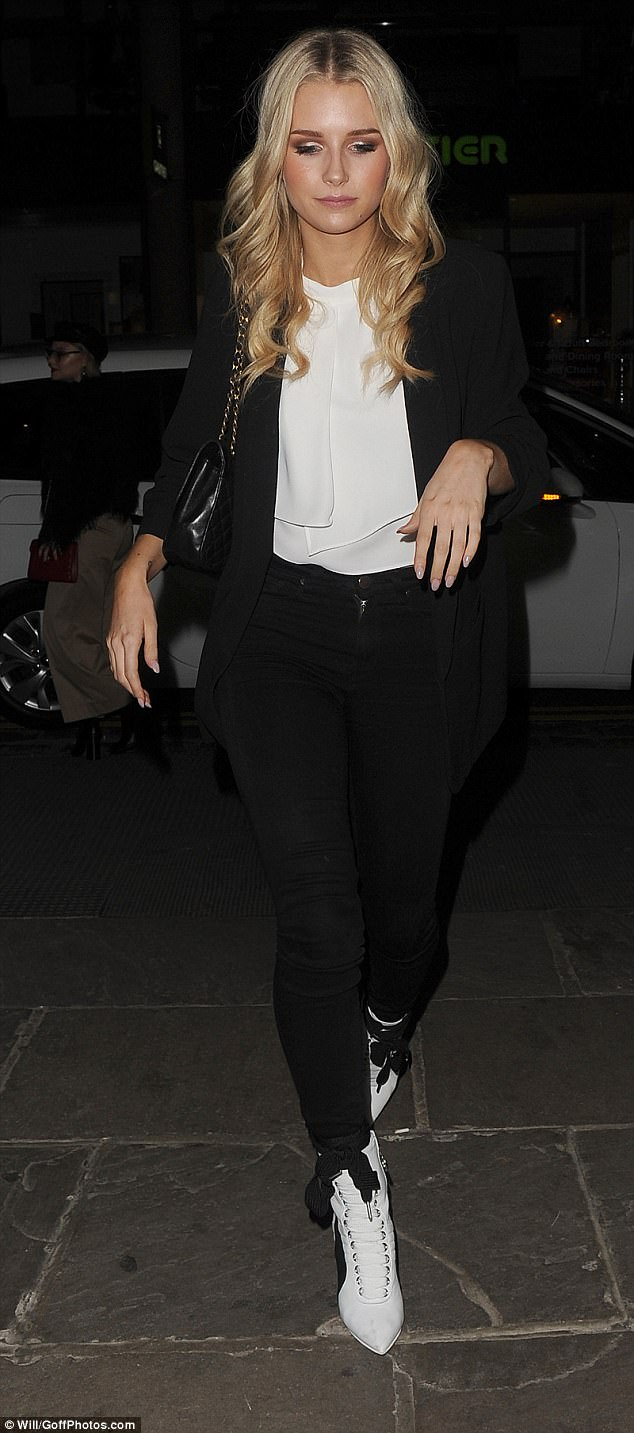 Walk this way: The beauty boosted her height in a pair of pointed lace-up white ankle boots as she tottered along