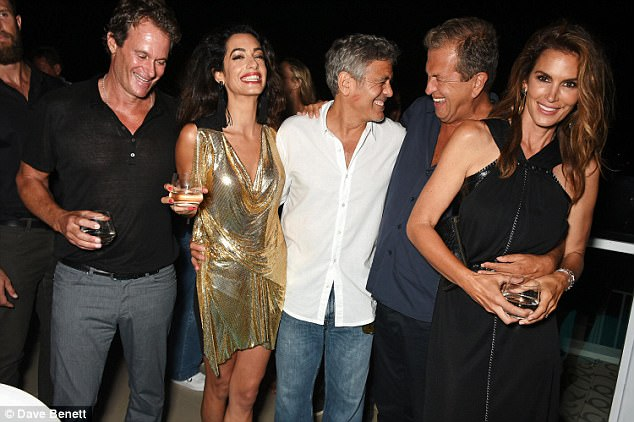 Best pals: George and Amal Clooney (centre), and their best friends Cindy Crawford (right) and Rande Gerber (left), have  bought adjacent properties... for the second time