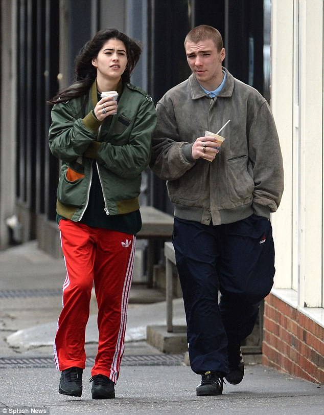 Teens in love: Rocco Ritchie, 16, looked very much loved up as he joined his 17-year-old girlfriend Kim Turnbull for a coffee run in New York on Wednesday