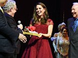 """LONDON, ENGLAND - APRIL 04:  Catherine, Duchess of Cambridge, accepts a gift of tap shoes from producers Michael Linnet, Michael Grade and director Mark Bramble during the Opening Night Royal Gala performance of """"42nd Street"""" in aid of the East Anglia Children's Hospice at the Theatre Royal Drury Lane on April 4, 2017 in London, England.  (Photo by David M. Benett/Dave Benett/Getty Images)"""