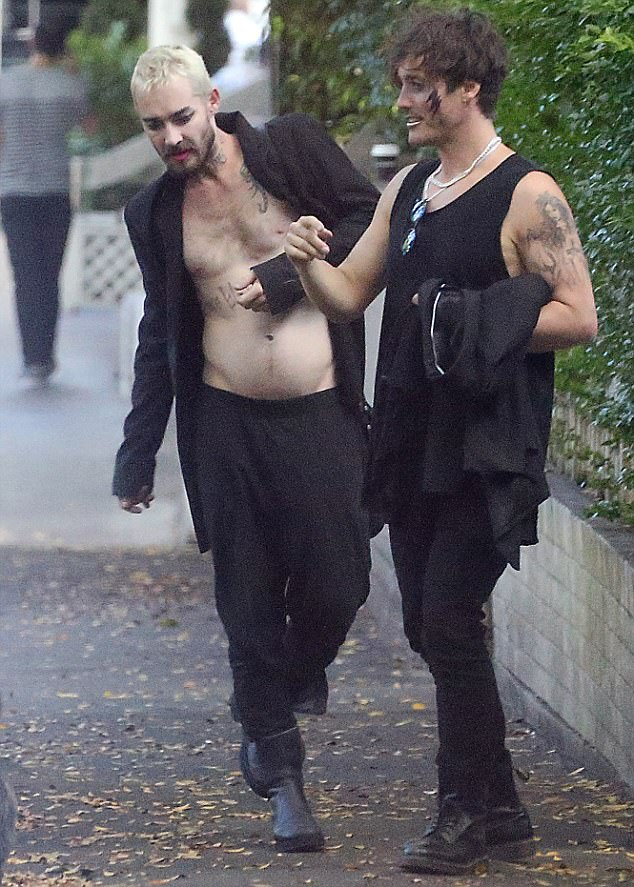 Stumbling: Daniel looked worse for wear while showing off his bare torso as he stumbled through Sydney with his pal Joshua back in December