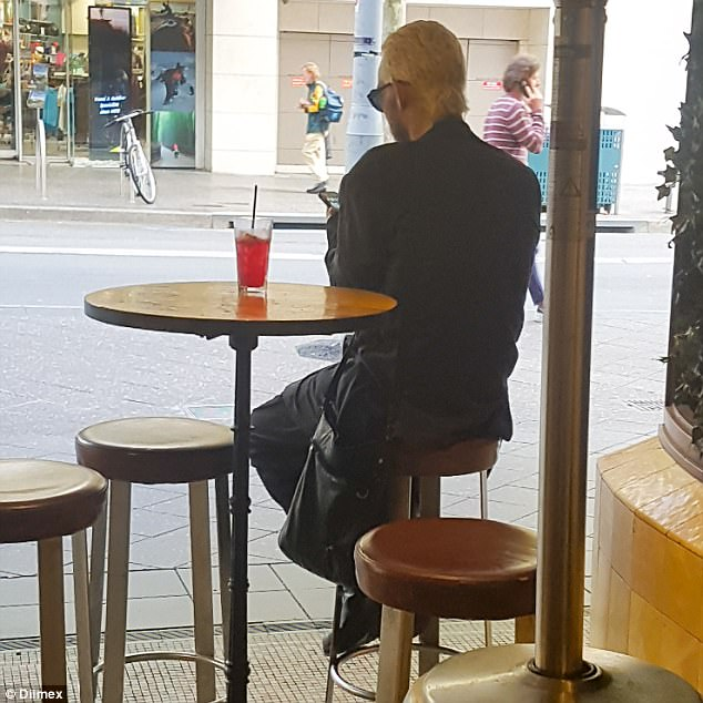 Back in black: Dressed in all-black, the Straight Lines hitmaker was seen enjoying a vodka beverage on his own at Bondi's The Eastern Hotel