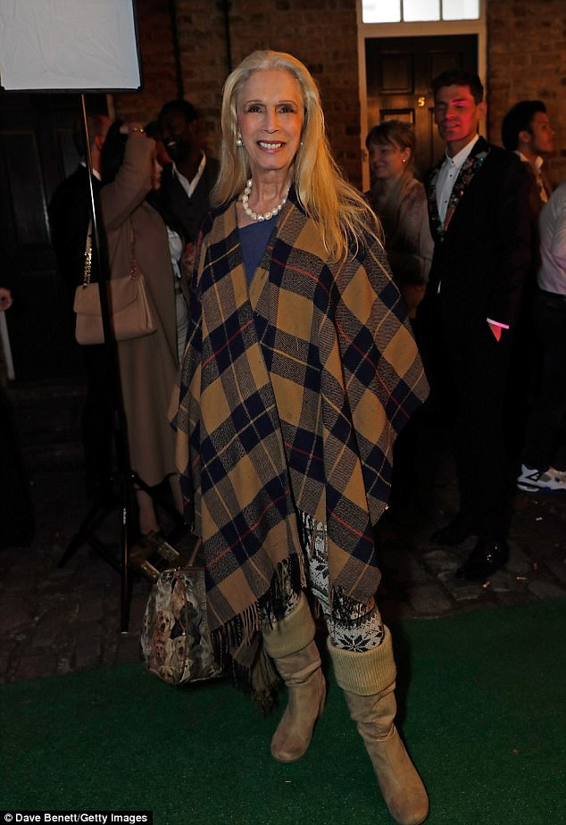 Wrapped up:Lady Colin Campbell kept warm in a checked poncho and boots at the bash
