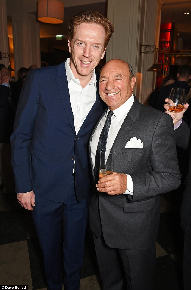 Two of a kind: Damian also posed for snaps with theatre chairman Arnold Crook on the night