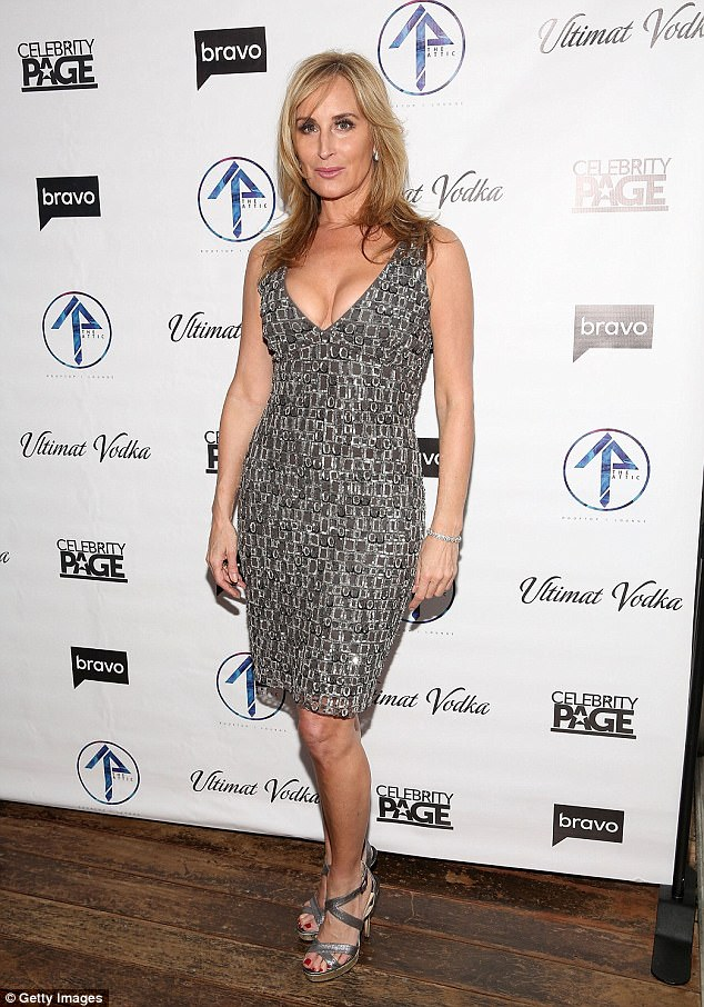 Simple:Sonja Morgan, 53, wore a very plunging grey dress and just a simple silver bracelet