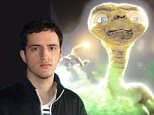 Bruno Borges, 24, poses with picture of popular fictional martial from the 1982 movie E.T.