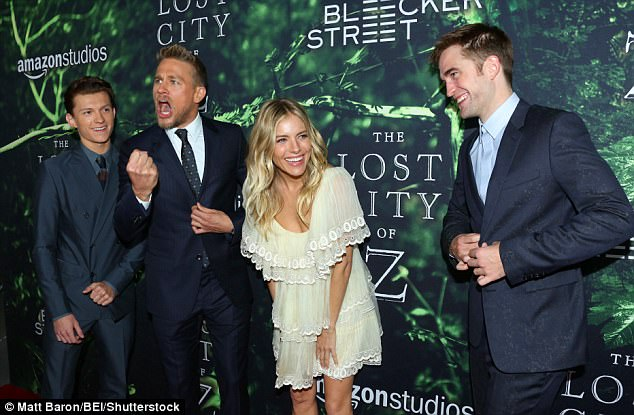 Joker: Accompanied by co-stars Tom Holland (left) and Sienna Miller (second right), the actor was suddenly full of jokes