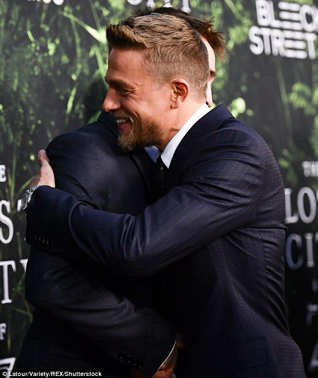 How Bromantic: The pair shared warm embrace, putting aside Charlie's comments about his co-star and their frosty relationship