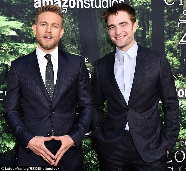 Friends again: Charlie Hunnam (left) and Robert Pattison (right) finally seemed to have forged a bond at theLost City of Z film premiere in LA on Wednesday, following Charlie's claim that the pair never spoke on set