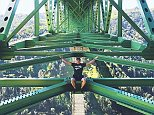 Shocking photos show young thrill-seekers posing for daring photos on the 730-foot-tall Foresthill Bridge near Sacramento in California