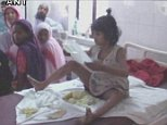 The eight-year-old 'Mowgli girl' is pictured on a hospital bed after being rescued by police in Bahraich district of Uttar Pradesh, India