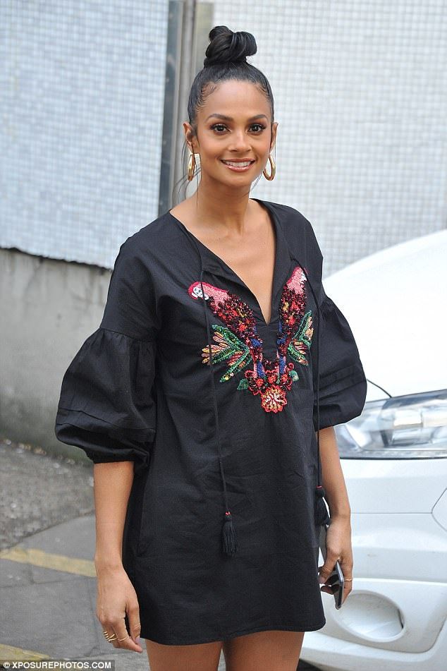 Tropical: Alesha wore a dress with sequinned parrots on the front
