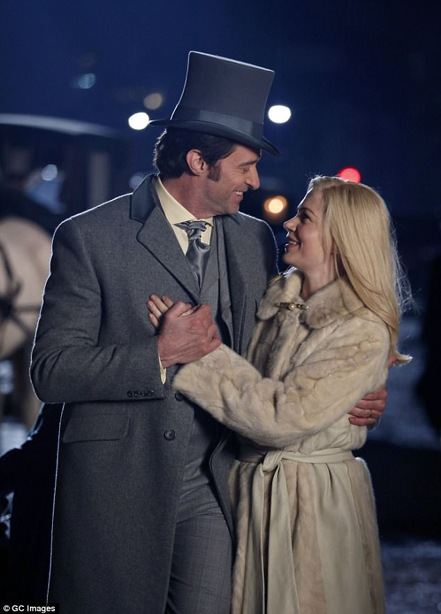 Look of love: Hugh Jackman, 48, and Michelle Williams, 36, look dreamily into each other's eyes while on set filming their new film The Greatest Showman in New York on Wednesday