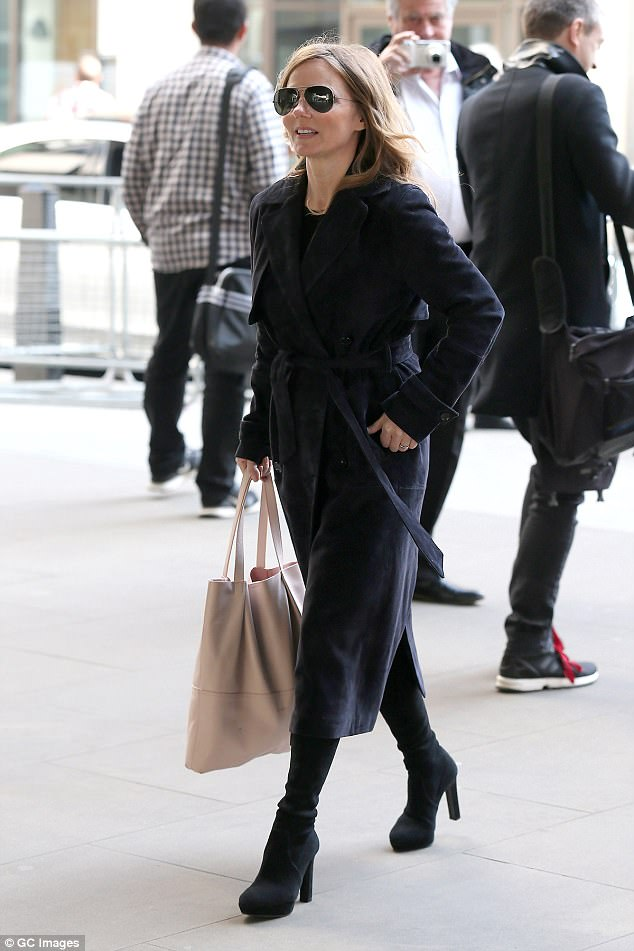 Stepping out: Geri appeared to be in good spirits as she strutted her stuff in her heeled knee-high boots