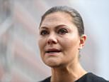 Crown Princess Victoria (pictured) looked visibly upset as she laid flowers at the scene in Stockholm today