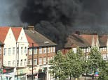 Smoke was seen billowing overshops near Kenton Station in Harrow this afternoon after a lorry caught fire