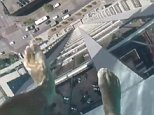 Sweat-inducing footage shows one brave resident walking along a glass-bottomed rooftop pool in Houston, Texas