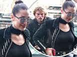 6.April.2017 - New York, NY Ò USA AG_808981 - New York, NY  - Bella Hadid spotted out and about in New York City after having drinks, and then sharing a smoke with a mystery man. She wore a large choker, a black leather moto jacket, a black top, blue jeans, and black leather boots. Pictured: Bella Hadid *STRICTLY AVAILABLE FOR UK USE ONLY* BYLINE MUST READ : AKM-GSI-XPOSURE ***UK CLIENTS - PICTURES CONTAINING CHILDREN PLEASE PIXELATE FACE PRIOR TO PUBLICATION *** UK CLIENTS MUST CALL PRIOR TO TV OR ONLINE USAGE PLEASE TELEPHONE 44 208 344 2007