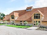 Stunning: This remarkable picture shows the result of a three-year transformation to turn an abandoned barn into a luxurious property - now worth £1.25million