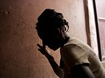 """In this Aug. 11, 2016 photo, Martine Gestime 32, wipes her tears during an interview in Port-au-Prince, Haiti. Gestime said she was raped by a Brazilian peacekeeper in 2008 and became pregnant with her son, Ashford. Unable to afford school for him, she relies on him to beg for food. """"He tells me all the time that he doesn't have a father or mother who can look after him."""" (AP Photo/Dieu Nalio Chery)"""