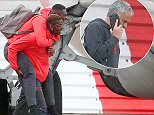 Paul Pogba was pictured giving Timothy Fosu-Mensah a piggy back as they boarded the plane