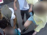 Mob: This is the moment a woman started kicking a man she accused of filming up her skirt on Oxford Street on Sunday