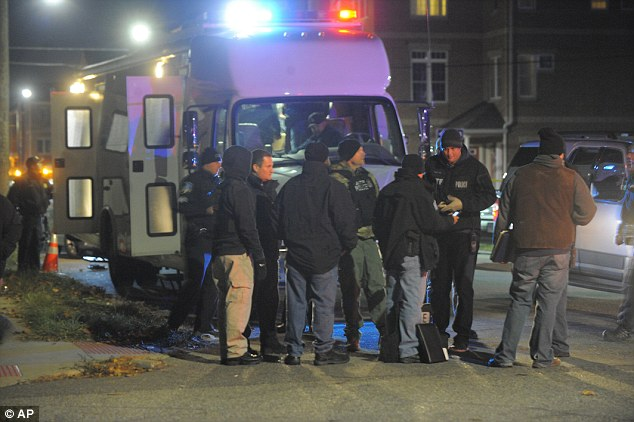 'It appears a similar type of situation here, an investigation and a suspect, for no apparent reason, decides to shoot an officer,' Craig said. Pictured are police on the scene on Tuesday night