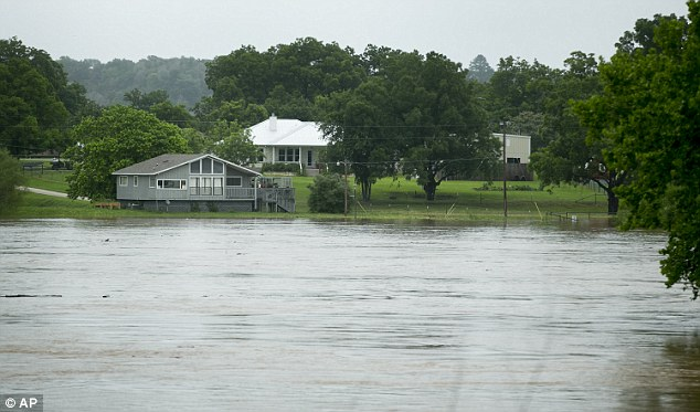 The Colorado River (pictured) inched closer to a house in the Doty River Estates in Smithville on Friday after a night of heavy rains
